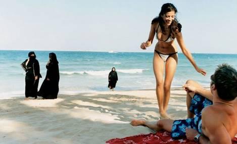 bikini and burka At the beach on Malaysia's Penang island