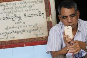 burmese-man-with-mobile-phone